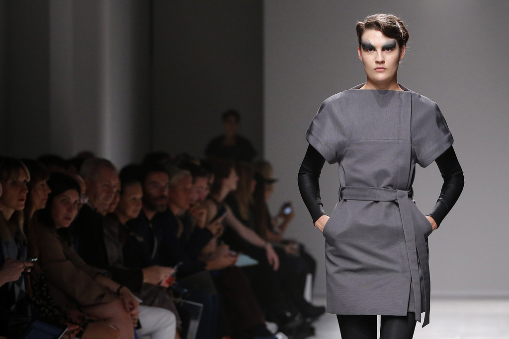 . A model presents a creation as part of British fashion designer Gareth Pugh\'s ready-to-wear Spring/Summer 2014 fashion collection presented in Paris, Wednesday, Sept. 25, 2013. (AP Photo/Jacques Brinon)