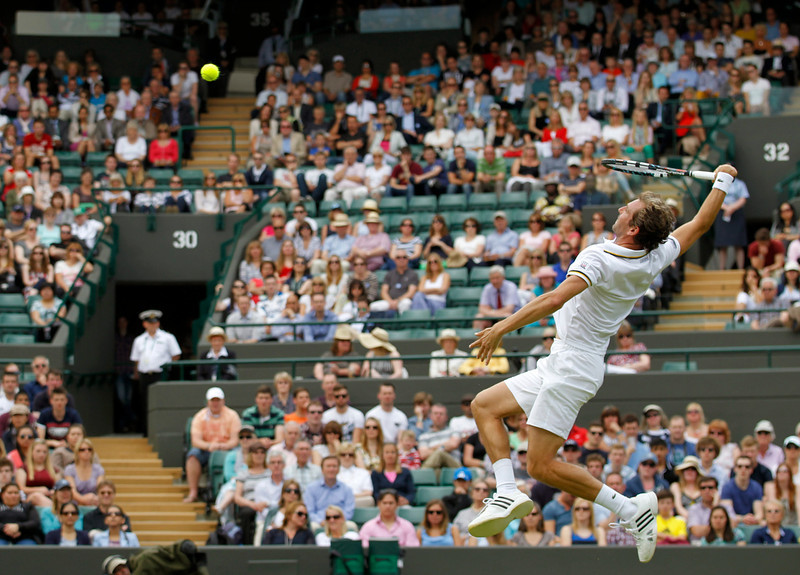 . Julien Benneteau of France smashes the ball to Fernando Verdasco of Spain during their Men\'s second round singles match at the All England Lawn Tennis Championships in Wimbledon, London,  Wednesday, June 26, 2013. (AP Photo/Sang Tan)
