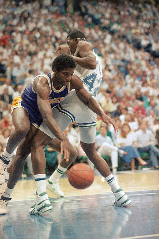 . Los Angeles Lakers forward A. C. Green (45) is blocked by the knee of Dallas Mavericks forward Roy Tarpley (42) in the first half of game six of the NBA Western Conference finals in Dallas on Thursday night, June 2, 1988. (AP Photo/Pat Sullivan)