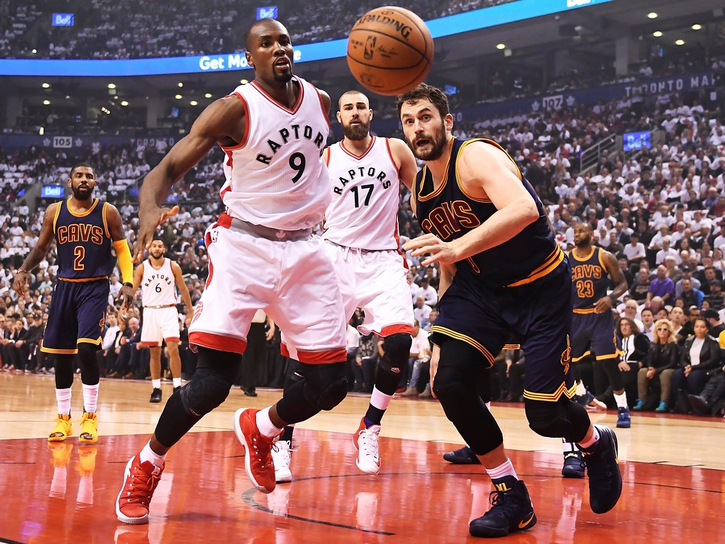 . Toronto Raptors forward Serge Ibaka (9) and Cleveland Cavaliers forward Kevin Love (0) watch the ball go out of bounds during the first half of Game 3 of an NBA basketball second-round playoff series in Toronto on Friday, May 5, 2017. (Frank Gunn/The Canadian Press via AP)