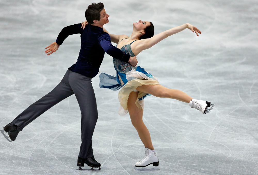 Description of . Tessa Virtue, right, and Scott Moir of Canada perform during the ice dance short dance event at the ISU Four Continents Figure Skating Championships in Osaka, western Japan, Friday, Feb. 8, 2013. (AP Photo/Shizuo Kambayashi)