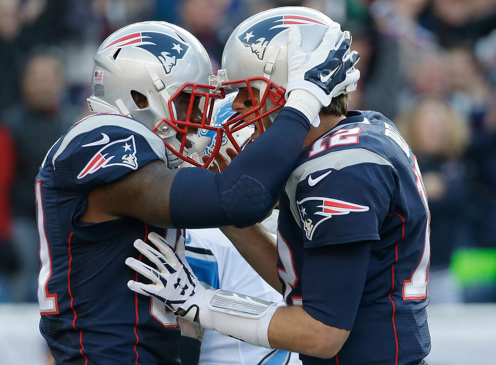. New England Patriots tight end Timothy Wright, left, celebrates after catching his second touchdown pass from Tom Brady, right, in the first half of an NFL football game against the Detroit Lions, Sunday, Nov. 23, 2014, in Foxborough, Mass. (AP Photo/Steven Senne)
