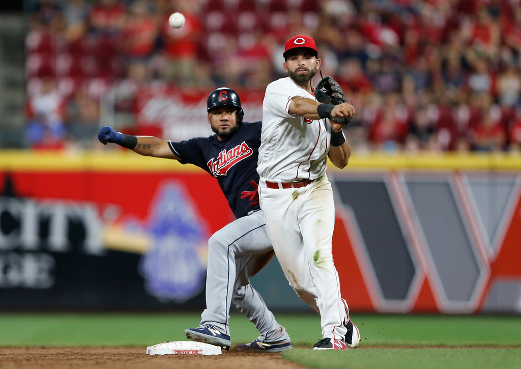 . Cleveland Indians\' Melky Cabrera, rear, is safe at second as Cincinnati Reds second baseman Jose Peraza, right, throws to third during the sixth inning of a baseball game, Monday, Aug. 13, 2018, in Cincinnati. (AP Photo/Gary Landers)