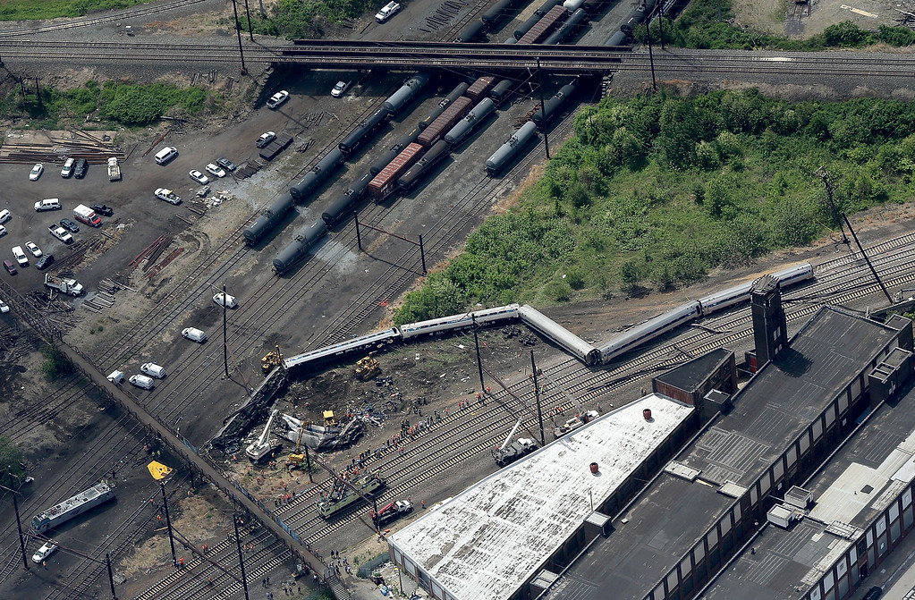 . Investigators and first responders work near the wreckage of Amtrak Northeast Regional Train 188, from Washington to New York, that derailed yesterday May 13, 2015 in north Philadelphia, Pennsylvania. At least six people were killed and more than 200 others were injured in the crash.  (Photo by Win McNamee/Getty Images)