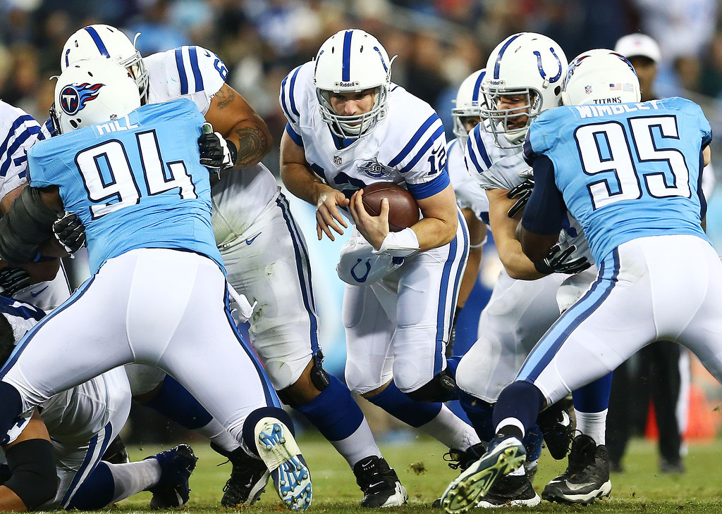 . NASHVILLE, TN - NOVEMBER 14:   Andrew Luck #12 of the Indianapolis Colts runs for a first down in the second quarter against the Tennessee Titans at LP Field on November 14, 2013 in Nashville, Tennessee.  (Photo by Andy Lyons/Getty Images)