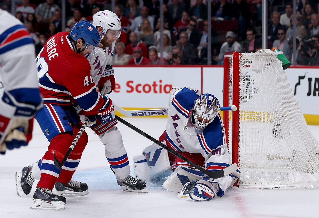 . MONTREAL, QC - MAY 17:  Goaltender Henrik Lundqvist #30 of the New York Rangers makes a save on an attempt by Daniel Briere #48 of the Montreal Canadiens in the first period in Game One of the Eastern Conference Finals of the 2014 NHL Stanley Cup Playoffs at the Bell Centre on May 17, 2014 in Montreal, Canada.  (Photo by Bruce Bennett/Getty Images)
