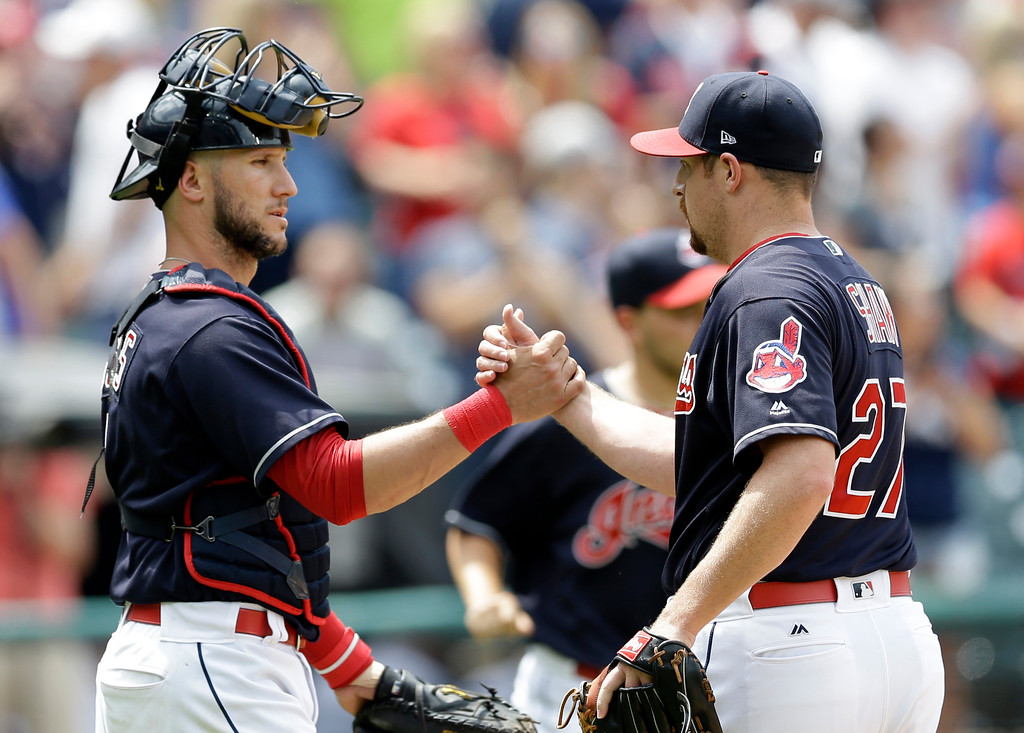 . Cleveland Indians\' Yan Gomes, left, and Bryan Shaw celebrate after the Indians defeated the Texas Rangers 5-1 in a baseball game, Thursday, June 29, 2017, in Cleveland. (AP Photo/Tony Dejak)