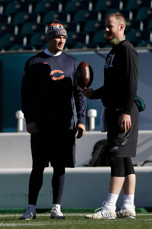 . Chicago Bears\' Mitchell Trubisky, left, and Philadelphia Eagles\' Carson Wentz talk before an NFL football game, Sunday, Nov. 26, 2017, in Philadelphia. (AP Photo/Michael Perez)