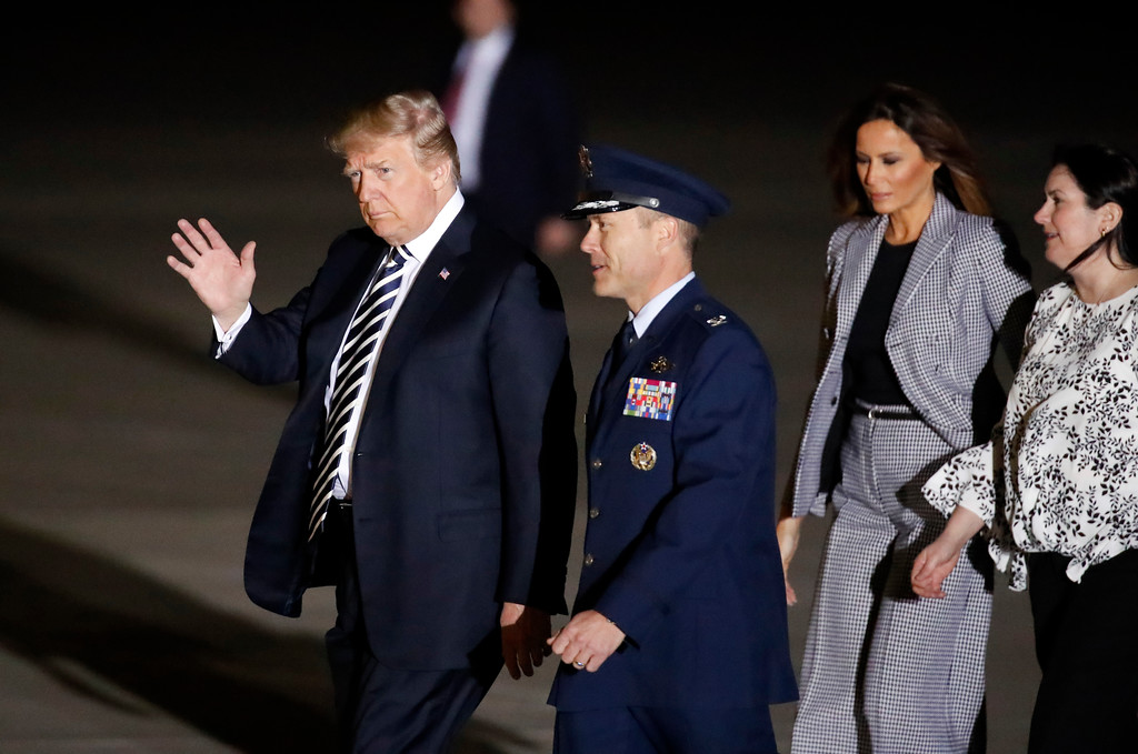 . President Donald Trump, left, and first lady Melania Trump, second right, arrive to greet former North Korean detainees Kim Dong Chul, Tony Kim and Kim Hak Song upon their expected arrival, Thursday, May 10, 2018, at Andrews Air Force Base, Md. (AP Photo/Alex Brandon)