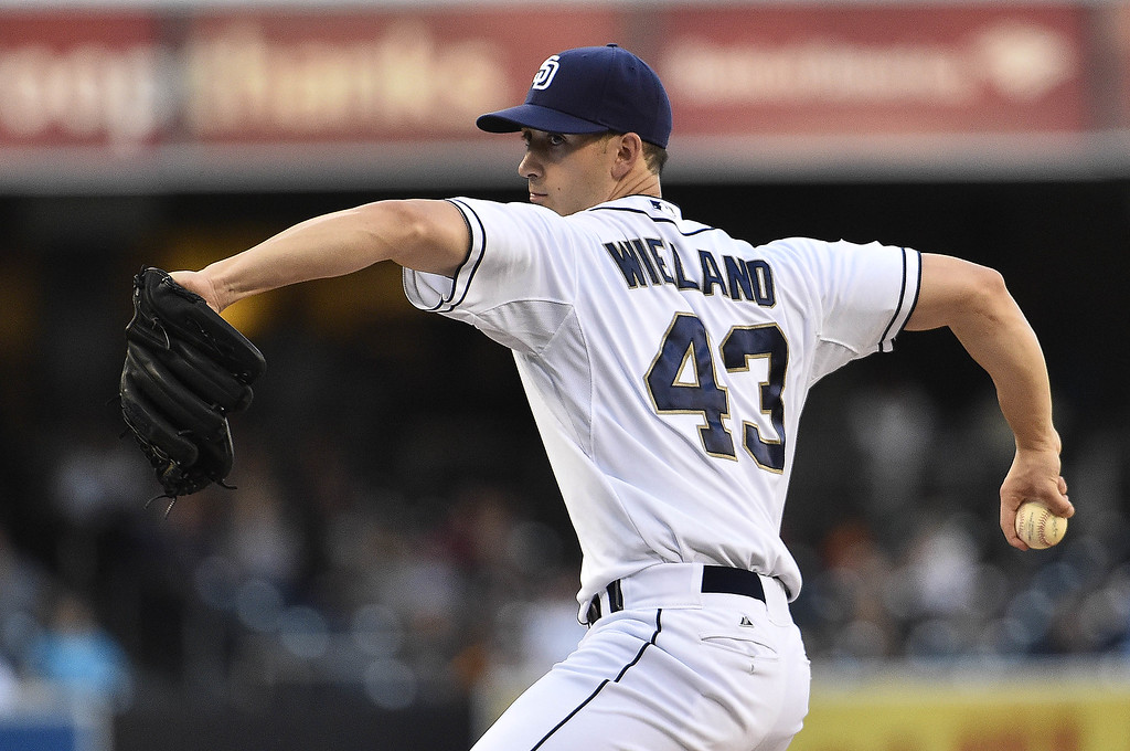 . SAN DIEGO, CA - SEPTEMBER 24:  Joe Wieland #43 of the San Diego Padres pitches during the first inning of a baseball game against the Colorado Rockies at Petco Park September, 24, 2014 in San Diego, California.  (Photo by Denis Poroy/Getty Images)