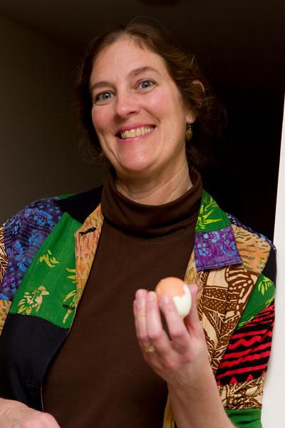Lisa peeling eggs for deviling.
