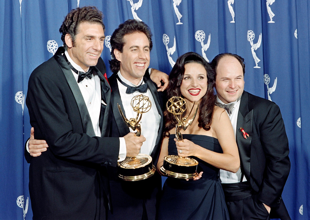 """. The cast of the Emmy-winning \""""Seinfeld\"""" show pose with the Emmys they won for Outstanding Comedy Series on September 19, 1993 in Pasadena, CA. From left to right:  Michael Richards, Jerry Seinfeld, Julia Louis-Dreyfus and Jason Alexander. (SCOTT FLYNN/AFP/Getty Images)"""