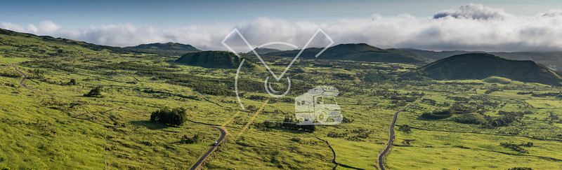 aerial like landscape from Pico da Urze overlooking the typical gree countryside of Planalto da Achada plains of Ilha do Pico island with several old volcano craters, calderas and cones, Azores