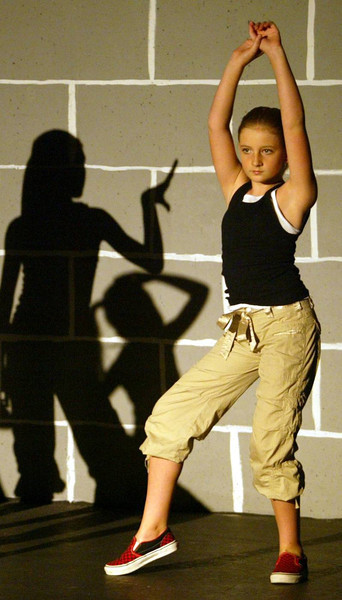 "The Full Force Hip-Hop & Jazz Co. held its 5th Annual Dance Showcase at Chico Theatre Company on Friday, May 11, 2007 in Chico, CA. Here is Lily Akers, 10, a member of the Mini Force Hip-Hop Dancers performing ""Ballin' Minis"". (Jason Halley/Chico Enterprise-Record)"