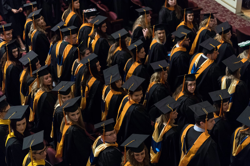 Graduate watch as the platform party approaches the stage. // University of Rochester School of Nursing Commencement, Kodak Hall at Eastman Theatre May 17, 2019.  // photo by J. Adam Fenster / University of Rochester
