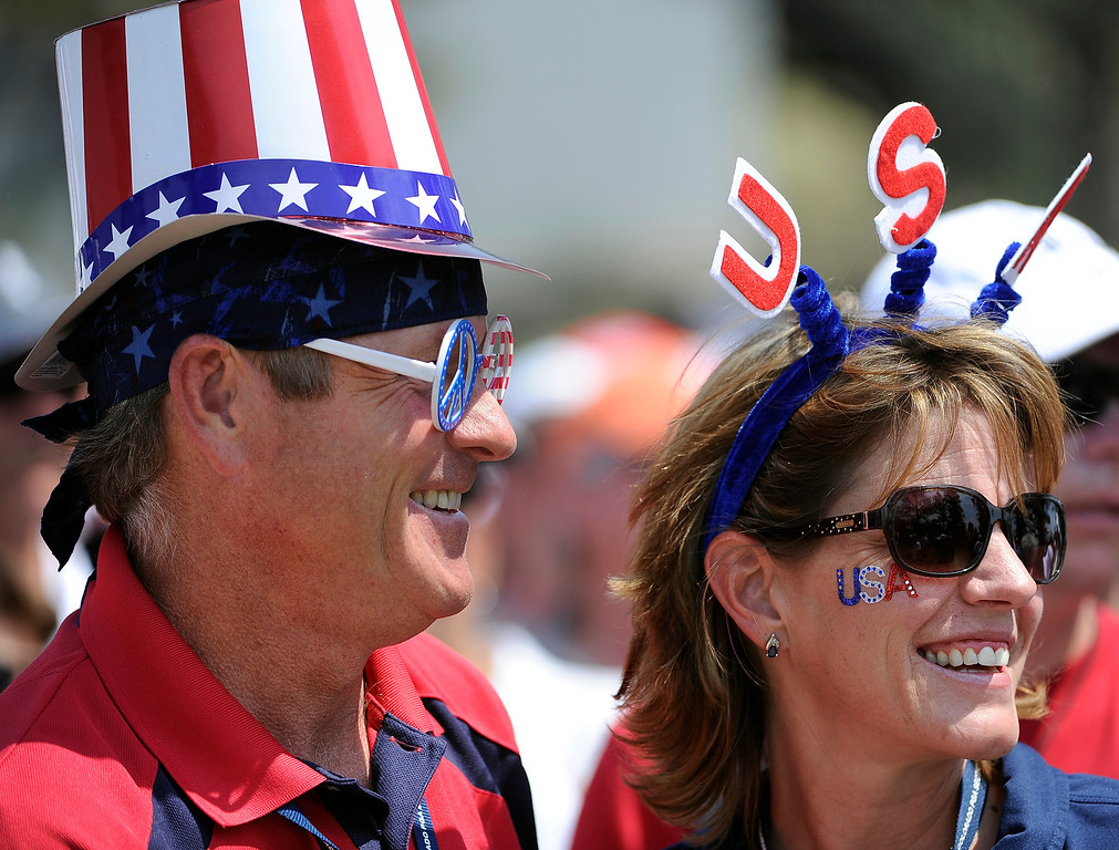 . PARKER, CO - Aug.17: Mark and Lisa Chamberlain  from Parker show their support for team USA.The 2013 Solheim Cup takes place at the Colorado Golf Club with the USA taking on Europe in the Saturday morning Foursomes Match. (Photo By Kathryn Scott Osler/The Denver Post)