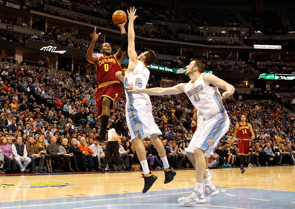 . C.J. Miles #0 of the Cleveland Cavaliers drives for a shot attempt in the first half against Danilo Gallinari #8 and Kosta Koufos #41 of the Denver Nuggets at Pepsi Center on January 11, 2013 in Denver, Colorado. (Photo by Chris Chambers/Getty Images)