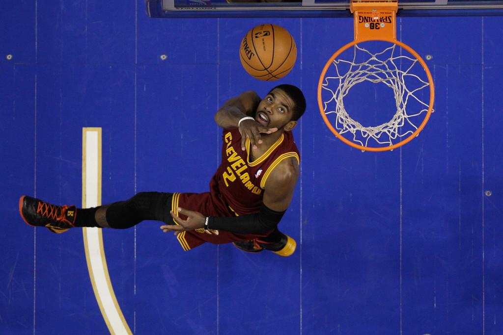. Cleveland Cavaliers\' Kyrie Irving in action during an NBA basketball game against the Philadelphia 76ers, Friday, Nov. 8, 2013, in Philadelphia. (AP Photo/Matt Slocum)