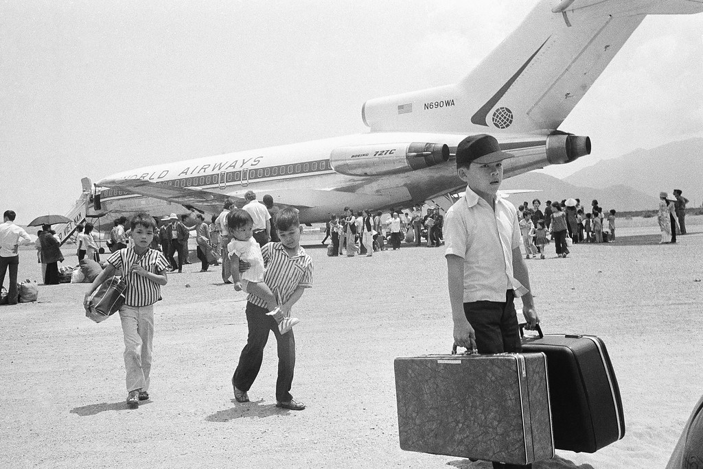 . South Vietnamese refugee deplane at Nha Trang airfield in Vietnam, Thursday, March 27, 1975 following a jet hop from Danang as a U.S. financed airlift, using civilian chartered jets, relocates thousands of former residents of Hue. (AP Photo/Nick Ut)