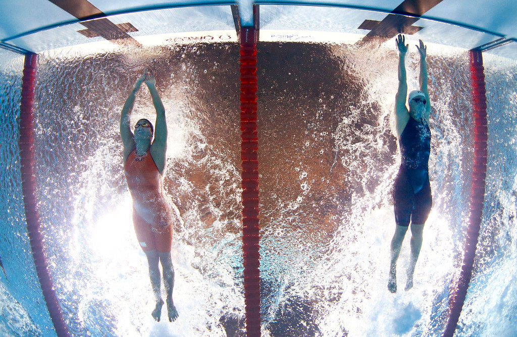 . Denmark\'s Jeanette Ottesen Gray, right, stretches to finish and win the gold medal in the Women\'s 50m butterfly final ahead of The Netherlands\' Ranomi Kromowidjojo, left, at the FINA Swimming World Championships in Barcelona, Spain, Saturday, Aug. 3, 2013. (AP Photo/David J. Phillip)