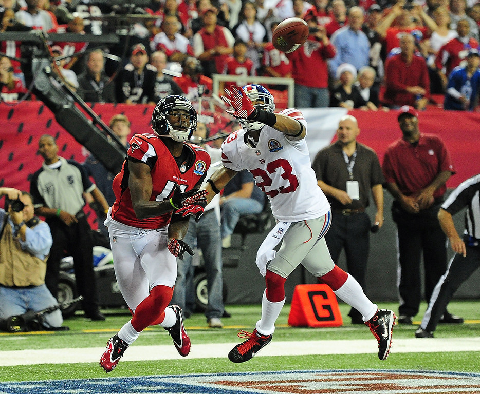 . Julio Jones #11 of the Atlanta Falcons looks to make a catch for a second half touchdown against Corey Webster #23 of the New York Giants at the Georgia Dome on December 16, 2012 in Atlanta, Georgia  (Photo by Scott Cunningham/Getty Images)