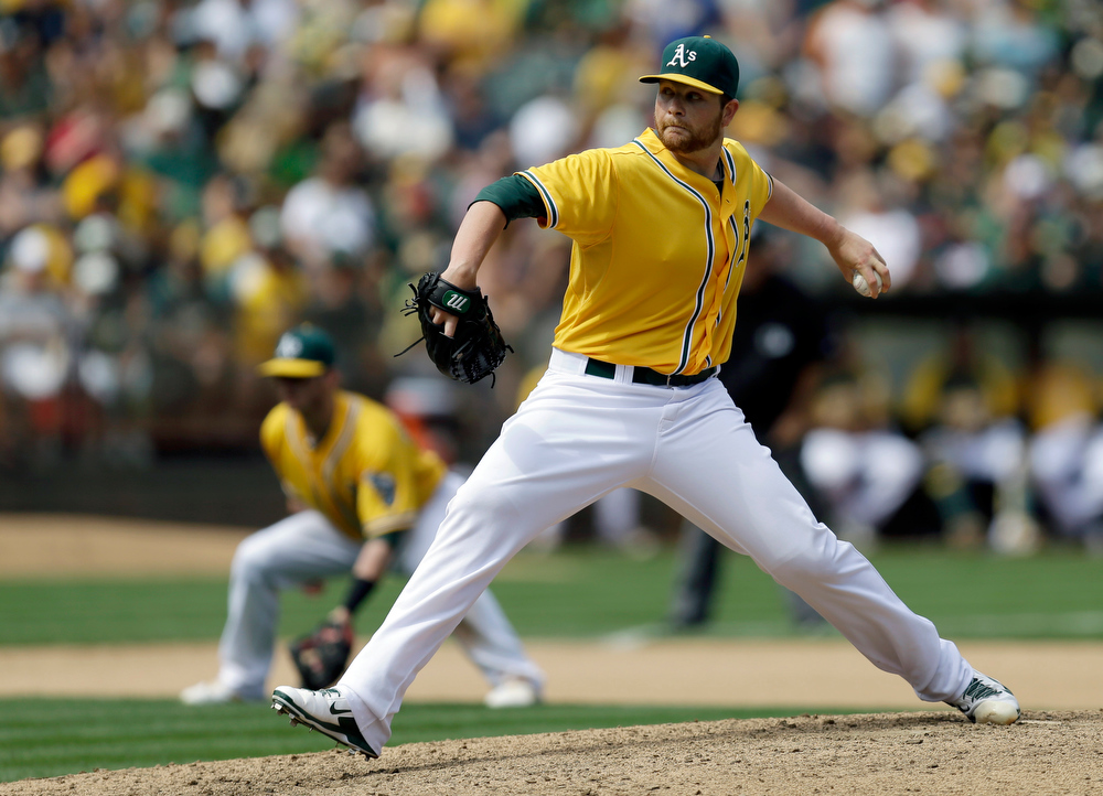 . Oakland Athletics\' Brett Anderson works against the Texas Rangers in the eighth inning of a baseball game Monday, Sept. 2, 2013, in Oakland, Calif. (AP Photo/Ben Margot)