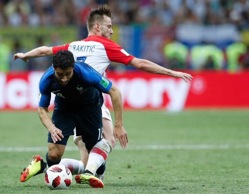 . France\'s Nabil Fekir is challenged by Croatia\'s Ivan Rakitic, right, during the final match between France and Croatia at the 2018 soccer World Cup in the Luzhniki Stadium in Moscow, Russia, Sunday, July 15, 2018. (AP Photo/Petr David Josek)