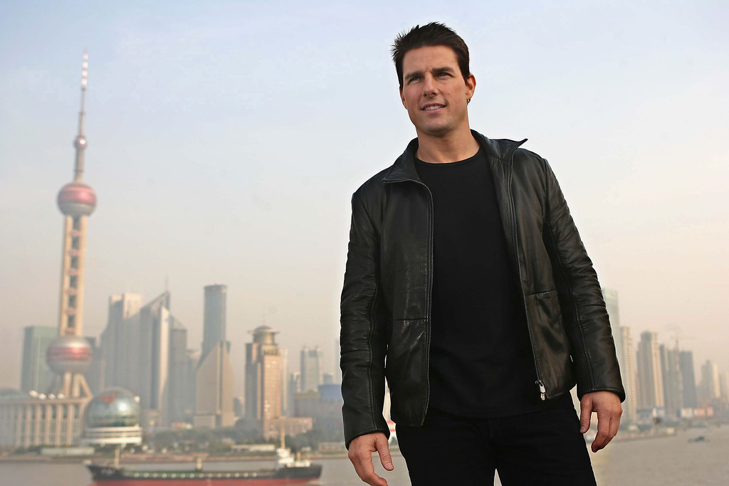 . Actor Tom Cruise poses for the press at the end of a news conference promoting his new film Mission Impossible III, atop Shanghai\'s historic Bund 18 building on November 30, 2005 in Shanghai, China. (Photo by China Photos/Getty Images)
