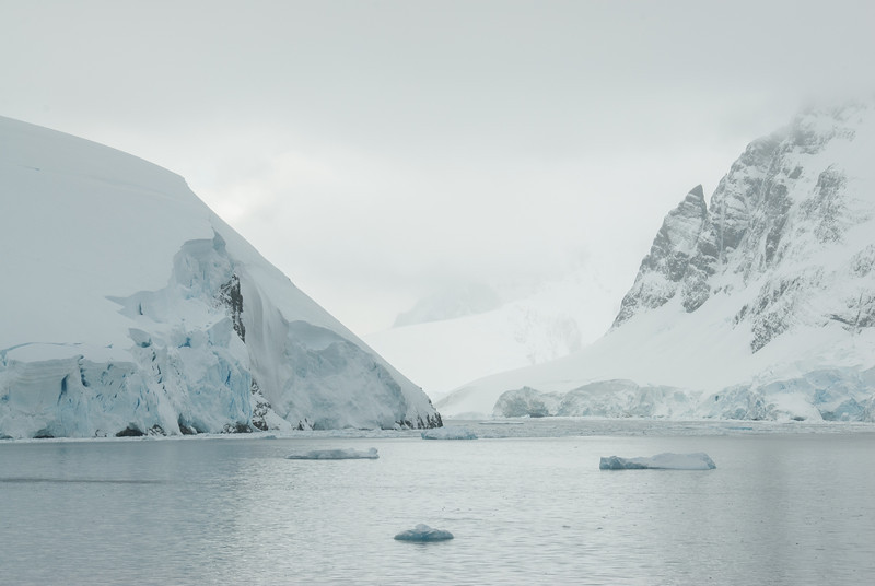 Snow covered mountains and cliffs in Lemaire Channel, Antarctica