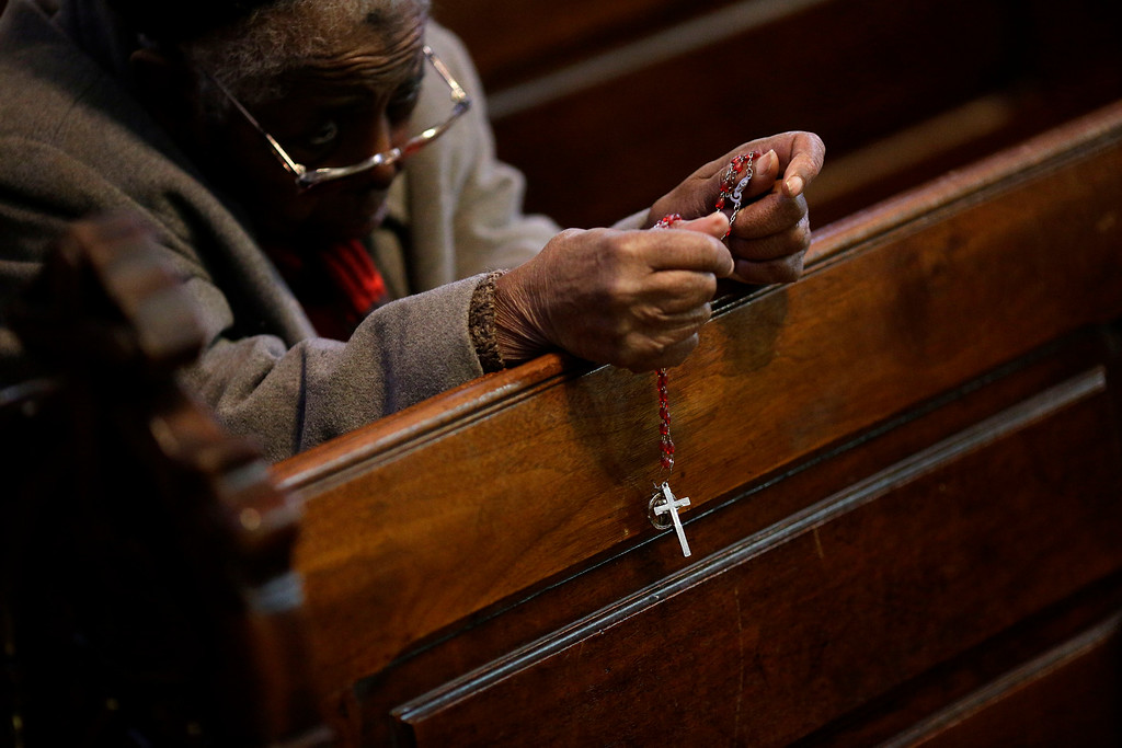 . A churchgoer holds a rosary during an Ash Wednesday Mass, Wednesday, Feb. 18, 2015, in Baltimore. Ash Wednesday marks the start of the Lent, a season of prayer and fasting for Christians before Easter. (AP Photo/Patrick Semansky)