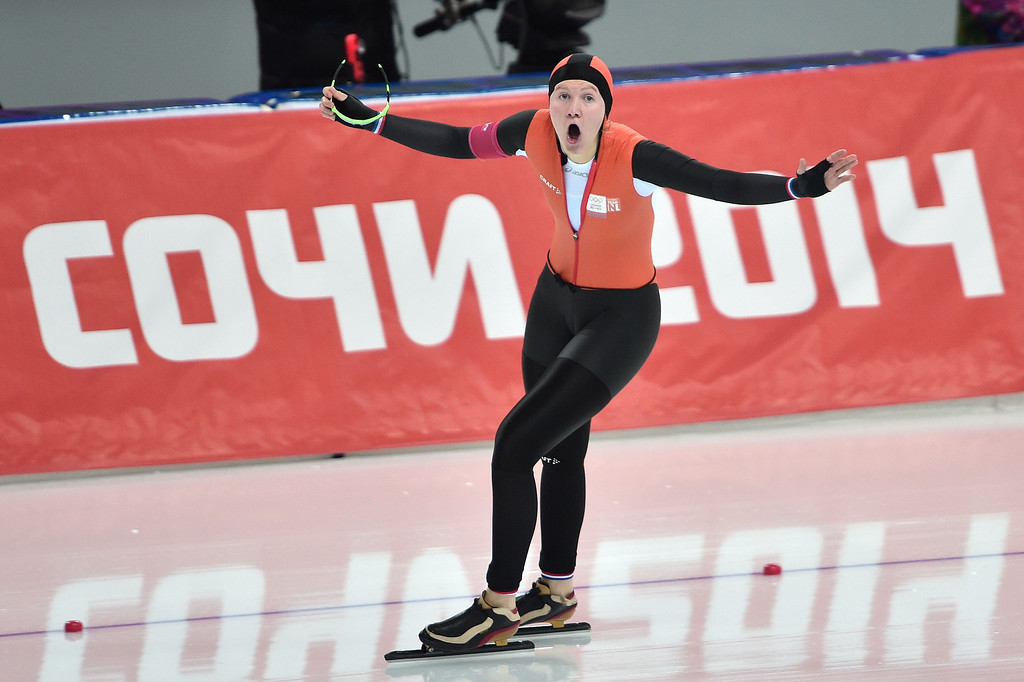 . Netherlands\' Charlotte van Beek celebrates as she crosses the finish line of the Women\'s Speed Skating 1500 m at the Adler Arena during the Sochi Winter Olympics on February 16, 2014.     DAMIEN MEYER/AFP/Getty Images