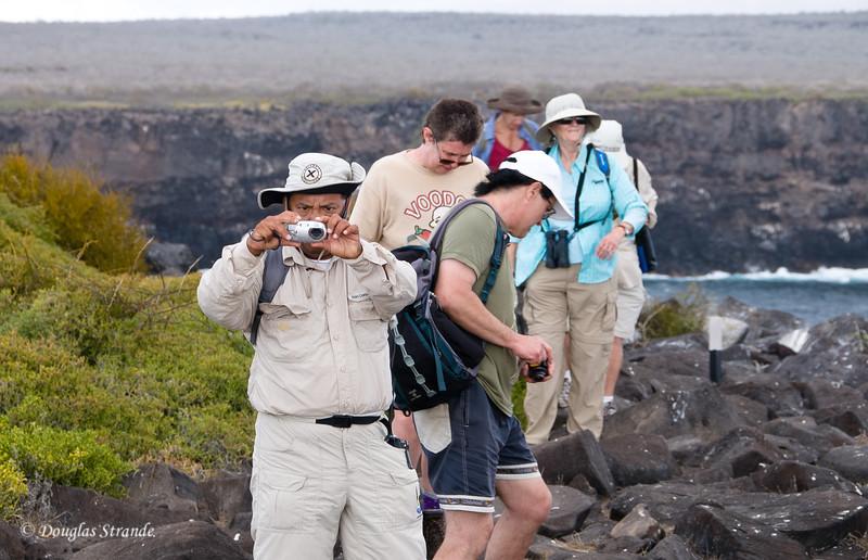 Naturalist, Jorge, grabs a photo at Punta Suarez, Espanola Island