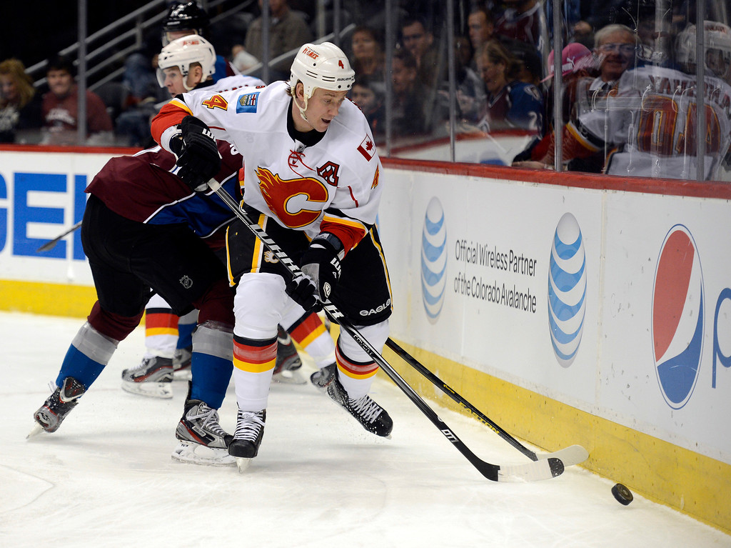 . DENVER, CO. - FEBRUARY 28: Jay Bouwmeester (4) of the Calgary Flames controls the puck along the boards during the first period against the Colorado Avalanche February 28, 2013 at Pepsi Center.(Photo By John Leyba/The Denver Post)