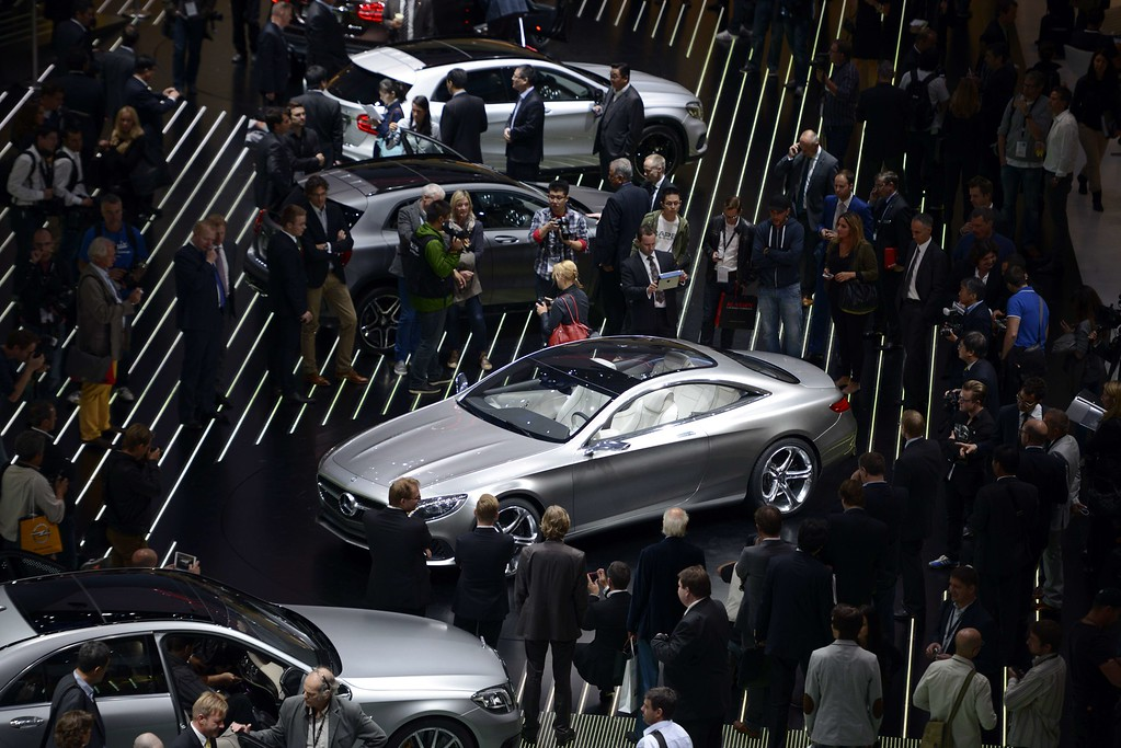 . Visitors crowd around Mercedes cars at the booth of Mercedes-Benz during the media day of the IAA (Internationale Automobil Ausstellung) international motor show in Frankfurt am Main, western Germany, on September 10, 2013.    AFP PHOTO / JOHANNES EISELE/AFP/Getty Images
