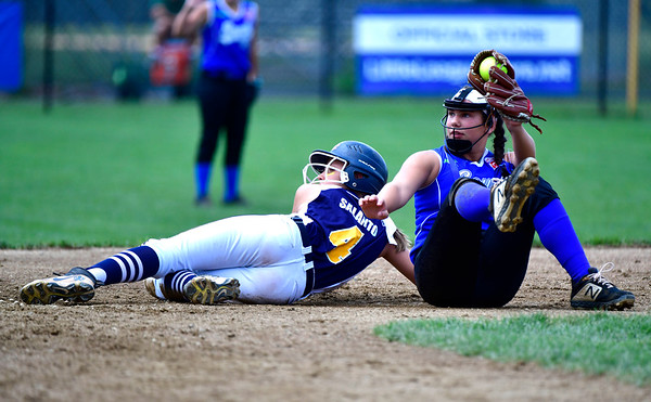 7/25/2019 Mike Orazzi | Staff Pennsylvania's Sage Lorson (14) and Connecticut's Talia Salanto (4) during the Eastern Regional Softball Tournament at Breen Field in Bristol on Thursday.