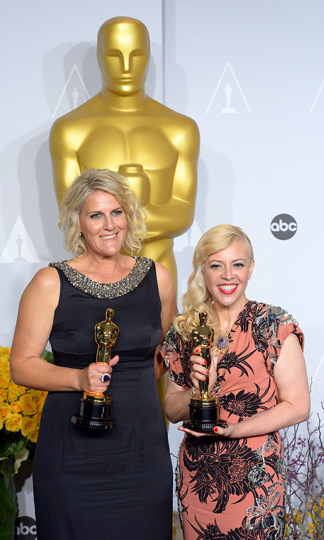". Beverly Dunn and Catherine Martin accept the Award for ""Achievement in Production Design\"" for the film The Great Gatsby,  backstage at the 86th Academy Awards at the Dolby Theatre in Hollywood, California on Sunday March 2, 2014 (Photo by David Crane / Los Angeles Daily News)"