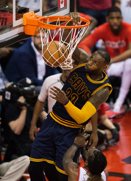 . Cleveland Cavaliers forward LeBron James dunks the ball past Toronto Raptors forward DeMarre Carroll during second half of Game 4 of the Eastern Conference finals in Toronto on May 23. James led the Cavs in points, assists and rebounds, with 29, 6 and 9, respectively, in the team\'s 105-99 loss. Toronto ties the series, 2-2. (Nathan Denette/The Canadian Press via AP)
