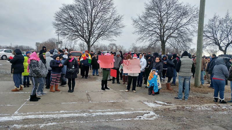 "Hundreds of people gather in the parking lot next to Creative Employment Opportunities, 345 Edison St. in Pontiac for the ""A Day Without Immigrants"" rally taking place across the nation on Thursday, Feb. 16, 2017."