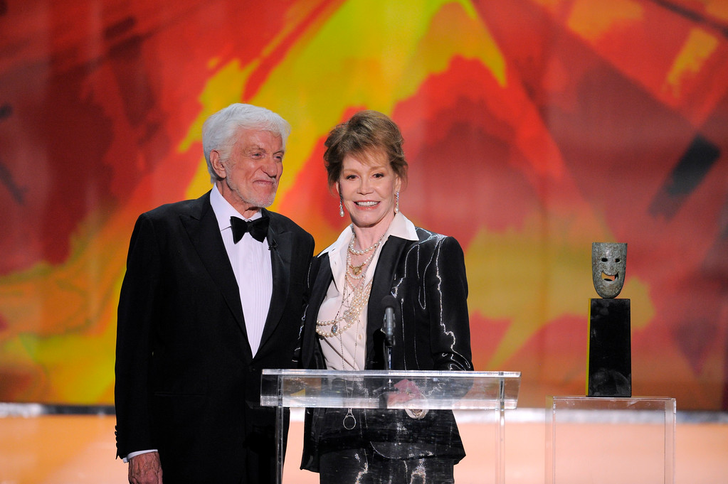 . Dick Van Dyke, left, presents the Life Achievement award onstage to Mary Tyler Moore at the 18th Annual Screen Actors Guild Awards on Sunday Jan. 29, 2012 in Los Angeles. (AP Photo/Mark J. Terrill)