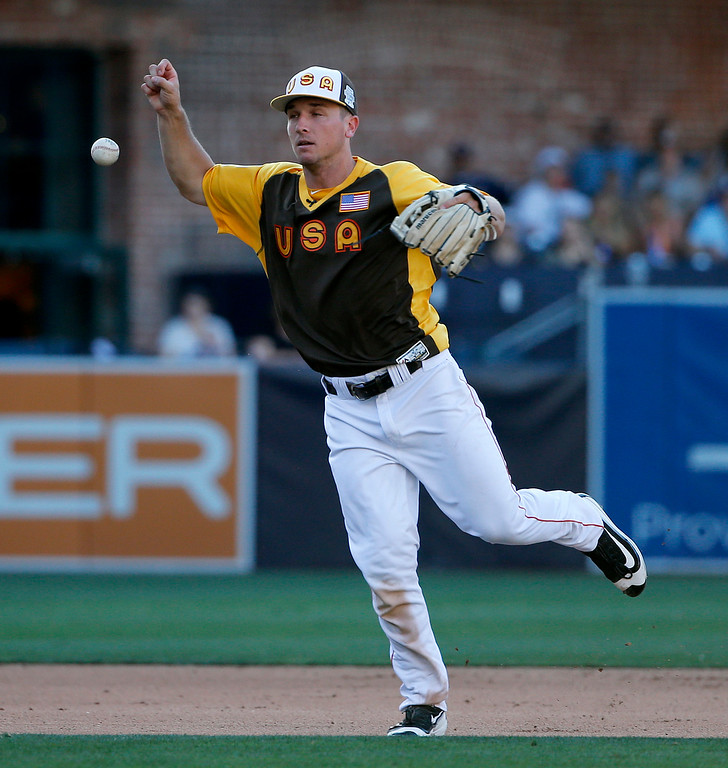 . U.S. Team\'s Alex Bergman, of the Houston Astros, bobbles a ball hit by World Team\'s Raimel Tapia, of the Colorado Rockies, during the eighth inning of the All-Star Futures baseball game, Sunday, July 10, 2016, in San Diego. (AP Photo/Lenny Ignelzi)