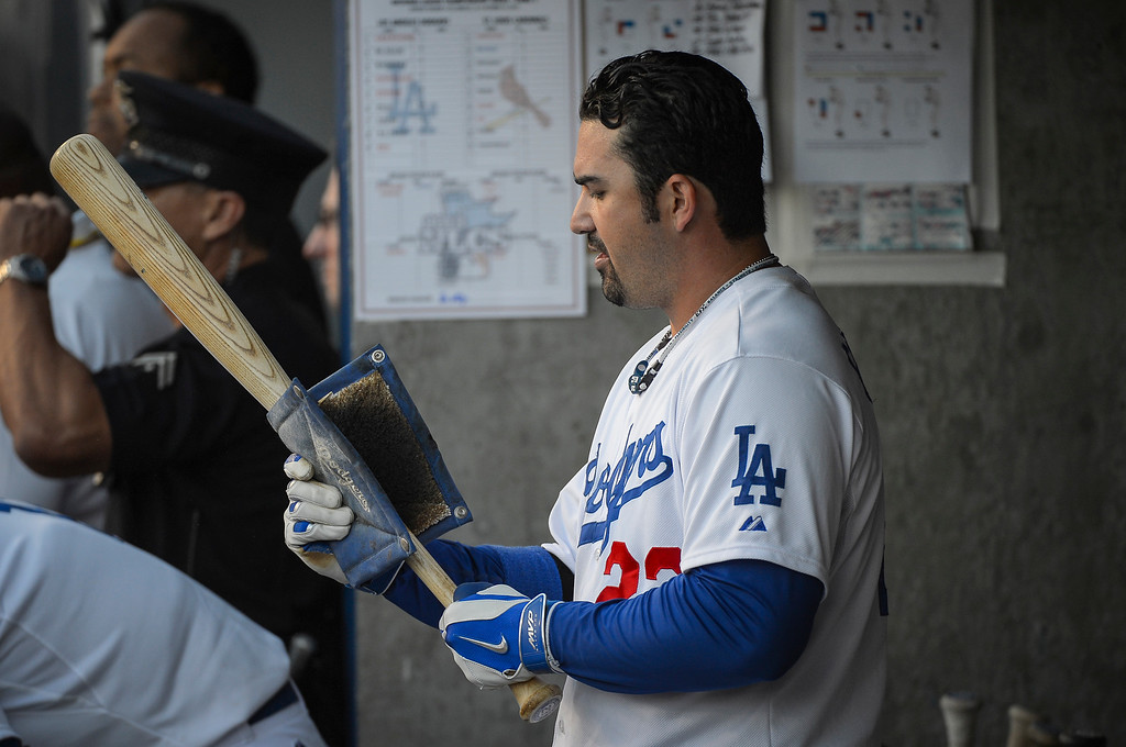 . Dodgers\' Adrian Gonzalez prepares his bat in the NLCS game 3 at Dodger Stadium Monday, October 14, 2013 ( Photo by Andy Holzman/Los Angeles Daily News )