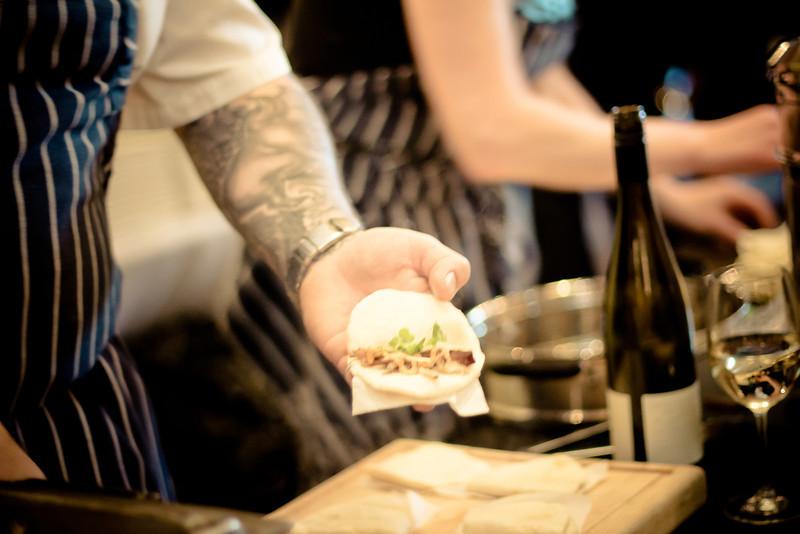 open kitchen pork bun hand.jpg