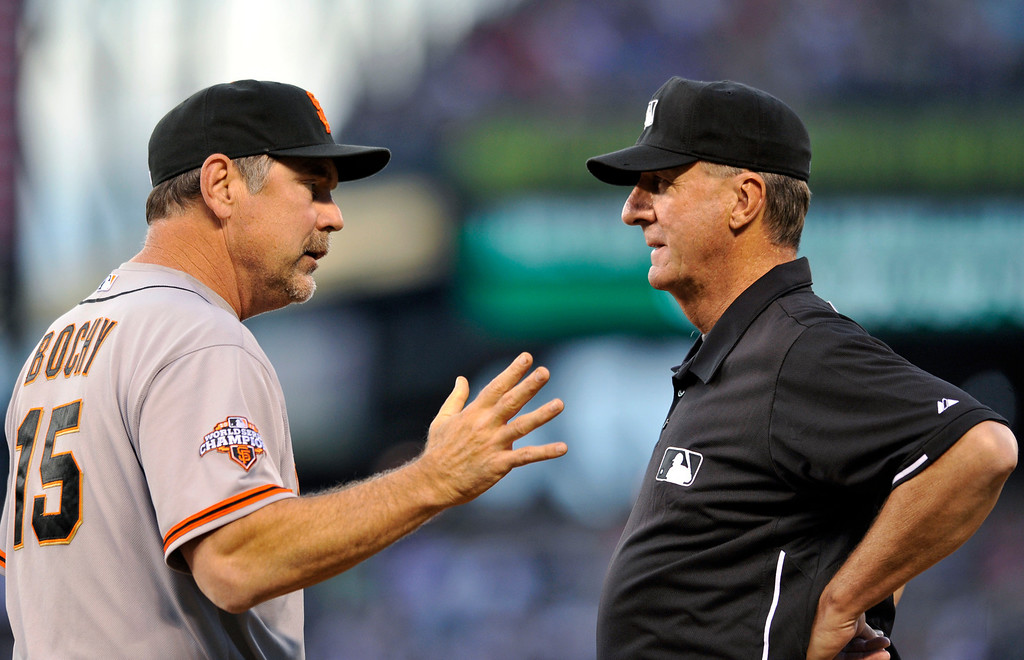 . San Francisco Giants manager Bruce Bochy (15) argues a call with first base umpire Tim McClelland over Colorado Rockies\' Dexter Fowler being safe at first during the third inning of a baseball game on Friday, May 17, 2013, in Denver. (AP Photo/Jack Dempsey)
