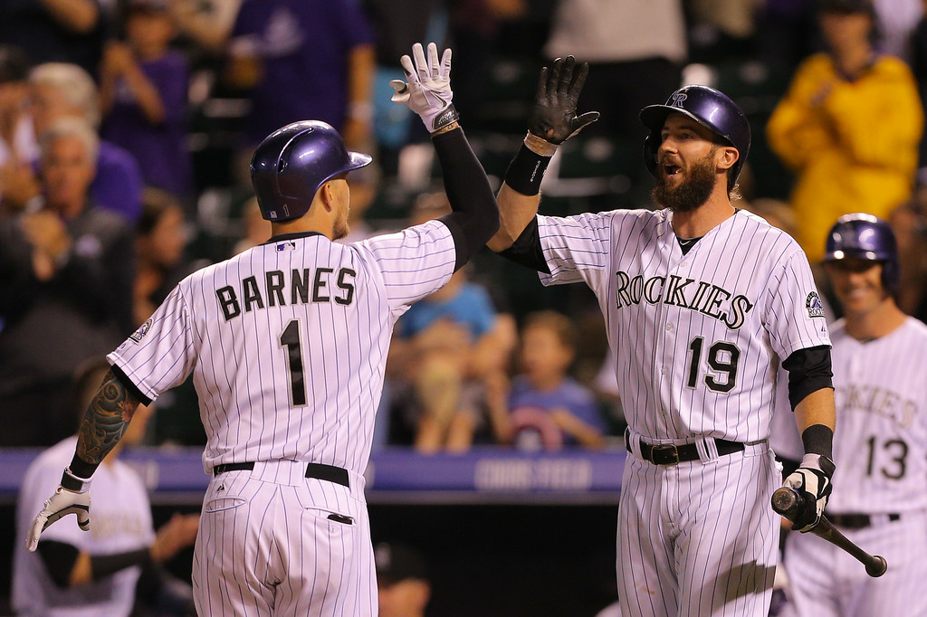 . DENVER, CO - JULY 11: Charlie Blackmon #19 of the Colorado Rockies congratulates Brandon Barnes #1 on his home run during the seventh inning against the Minnesota Twins at Coors Field on July 11, 2014 in Denver, Colorado. The Rockies defeated the Twins 6-2. (Photo by Justin Edmonds/Getty Images)