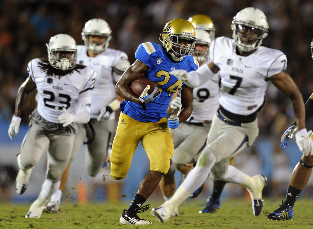 . UCLA RB Paul Perkins peels off a 46-yard run in the fourth quarter against Nevada, Saturday, August 31, 2013, at the Rose Bowl. (Michael Owen Baker/L.A. Daily News)