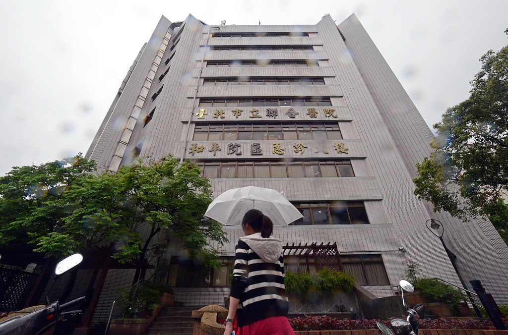 . A woman walks in the rain past the front of Taipei Hoping Hospital on April 6, 2013 which contains 191 negative pressure isolation units set up to treat potential new H7N9 avian influenza cases.  Taiwan enhanced its level of alert against bird flu and set up a contingency centre on April 3 after reports in mainland China of new infections from a new strain of avian influenza. The new infections alarmed the authorities in Taiwan, which is separated from the Chinese mainland only by a 180-kilometre (111.6 miles) strait and which has seen a dramatic influx of 2.6 million Chinese visitors last year due to the fast warming ties between Taipei and Beijing.       SAM YEH/AFP/Getty Images