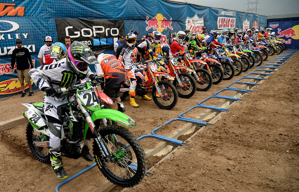 . Brett Metcalfe (24) and racers are in the start line of 450 Class Moto #1 at Thunder Valley MX Park during the third round of the Lucas Oil Pro Motocross Championship. Lakewood, Colorado. June 07. 2014. (Photo by Hyoung Chang/The Denver Post)