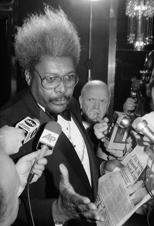. Boxing promoter Don King reacts to an article in Wednesday?s edition of Newsday during a press conference in New York on Wednesday, Jan. 23, 1985. According to the article the FBI reportedly tried and failed to catch King in illegal acts. King said he knew nothing of the operation. (AP Photo/Ray Stubblebine)