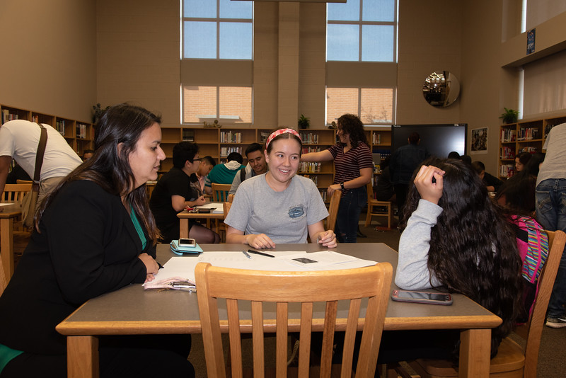 Mara Barbosa (left), and Veronica Fernandez with a West Oso High School student at the Spanish event at the library.