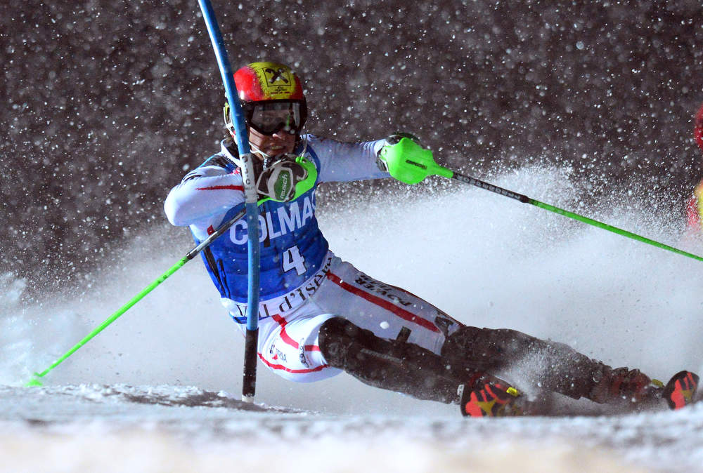 Description of . Marcel Hirscher of Austria clears a gate in his second run in the FIS Alpine World Cup Men's Slalom on December 8, 2012 in Val d'Isere, French Alps. Alexis Pinturault of France won the race ahead Felix Neureuther of Germany and Marcel Hirscher of Austria. AFP PHOTO / FRANCK  FIFE/AFP/Getty Images